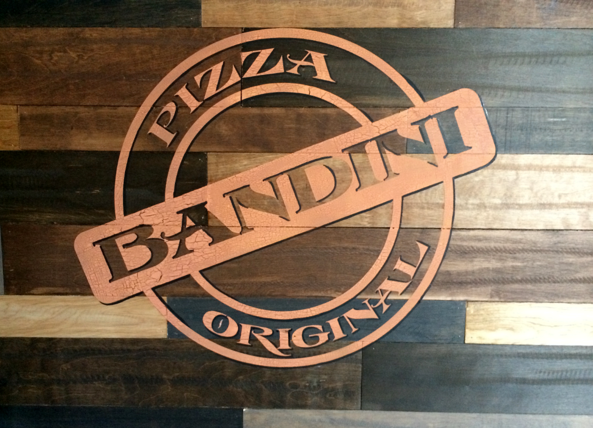 Cracked paint technique for Bandini's Pizza stamp on wooden wall