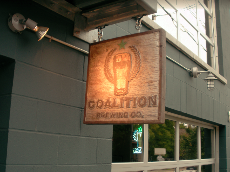 Carved double sided hanging sign for Coalition Brewing